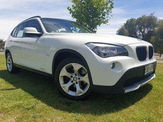 2011 BMW X1 E84 MY0911 sDrive18i Steptronic White 6 Speed Sports Automatic Wagon.