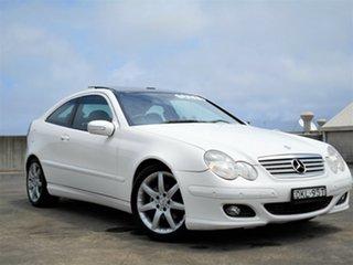 2005 Mercedes-Benz C-Class CL203 MY2005 C200 Kompressor Sports Evolution White 5 Speed Automatic.