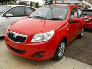 2010 Holden Barina TK MY10 Red 5 Speed Manual Hatchback.