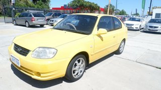 2005 Hyundai Accent LC MY04 GL Yellow 4 Speed Automatic Hatchback.