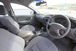 2002 Ford Falcon AU III SR Forte White 4 Speed Automatic Sedan.