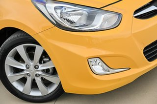 2013 Hyundai Accent RB Elite Yellow 5 Speed Manual Sedan.