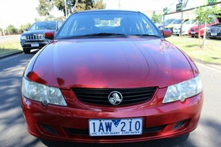 2002 Holden Commodore VY Acclaim Maroon 4 Speed Automatic Sedan.