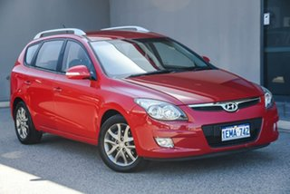 2012 Hyundai i30 FD MY11 SLX cw Wagon Red/Black 4 Speed Automatic Wagon.