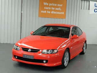 2002 Holden Monaro V2 CV6 Orange 4 Speed Automatic Coupe.