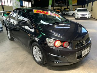 2012 Holden Barina TM MY13 CD Black 6 Speed Automatic Sedan.