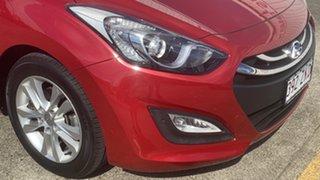 2014 Hyundai i30 GD2 MY14 Trophy Firey Red 6 Speed Manual Hatchback.