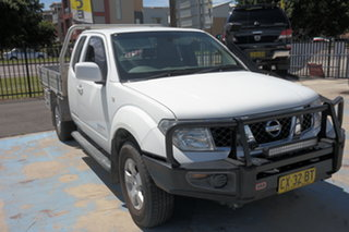 2009 Nissan Navara D40 ST-X King Cab White 5 Speed Automatic Cab Chassis.
