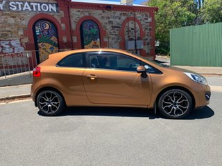 2012 Kia Rio UB MY12 SLS Burnt Caramel/black 6 Speed Manual Hatchback.