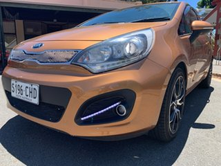 2012 Kia Rio UB MY12 SLS Burnt Caramel/black 6 Speed Manual Hatchback