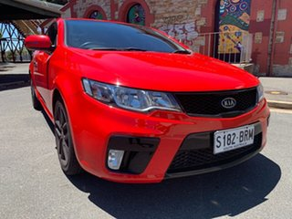 2011 Kia Cerato TD MY11 Koup SLS Red/Black 6 Speed Manual Coupe.
