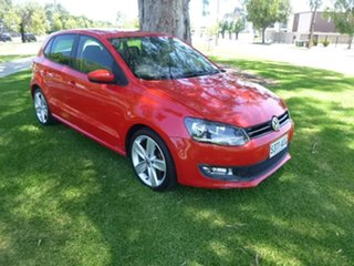 2011 Volkswagen Polo 6R 77TSI Comfortline Red Manual Hatchback.