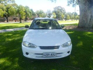 2003 Mitsubishi Mirage CE White 4 Speed Automatic Hatchback.