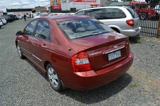 2005 Kia Cerato LD Red 4 Speed Automatic Sedan.