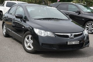 2007 Honda Civic 8th Gen MY07 VTi Black 5 Speed Manual Sedan.