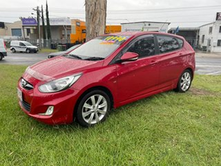 2011 Hyundai Accent RB Active Red 4 Speed Sports Automatic Hatchback.