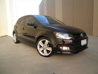 2012 Volkswagen Polo 6R MY12.5 77TSI Comfortline Black Pearlescent 6 Speed Manual Hatchback.