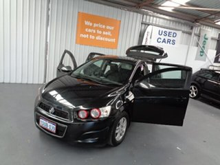 2011 Holden Barina TK MY11 Black 5 Speed Manual Hatchback.