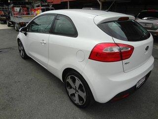 2012 Kia Rio UB MY13 SLS White 6 Speed Automatic Hatchback.