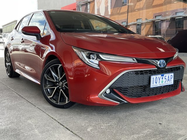 Pre-Owned Toyota Corolla ZWE211R ZR E-CVT Hybrid Preston, 2019 Toyota Corolla ZWE211R ZR E-CVT Hybrid Volcanic Red 10 Speed Constant Variable Hatchback Hybrid