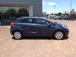 2011 Kia Rio Blue Automatic Hatchback.
