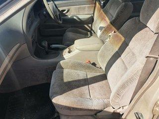 1998 Ford Fairmont EL Ghia Gold 4 Speed Automatic Sedan.