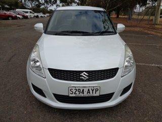 2013 Suzuki Swift FZ GL White 4 Speed Automatic Hatchback.
