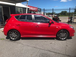 2011 Hyundai i30 FD MY11 SLX 1.6 CRDi Red 5 Speed Manual Hatchback.