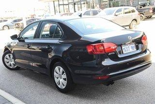 2012 Volkswagen Jetta 1B MY13 118TSI DSG Black 7 Speed Sports Automatic Dual Clutch Sedan.