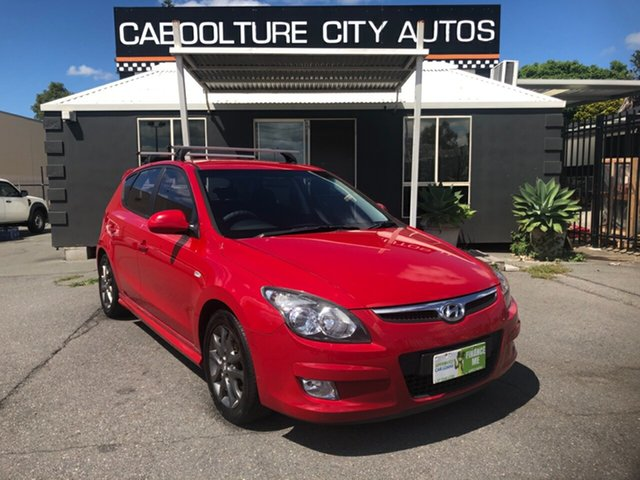 Used Hyundai i30 FD MY11 SLX 1.6 CRDi Morayfield, 2011 Hyundai i30 FD MY11 SLX 1.6 CRDi Red 5 Speed Manual Hatchback