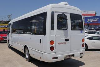 2011 Fuso Rosa White Bus.
