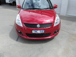 2011 Suzuki Swift FZ GLX Red 4 Speed Automatic Hatchback.