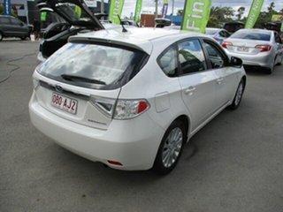2008 Subaru Impreza White 5 Speed Manual Hatchback.