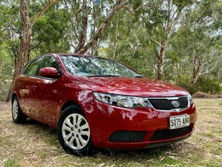 2011 Kia Cerato TD MY12 SI Spicy Red/dark Grey 6 Speed Manual Hatchback.