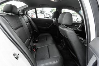 2009 BMW 3 Series E90 MY09 320i Steptronic Executive White 6 Speed Sports Automatic Sedan