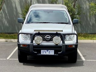 2010 Nissan Navara D40 RX King Cab White 5 Speed Automatic Cab Chassis.