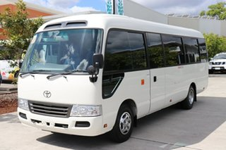 2016 Toyota Coaster 50 Deluxe White Automatic Midi Coach.