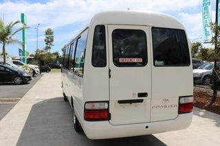 2016 Toyota Coaster 50 Deluxe White Automatic Midi Coach