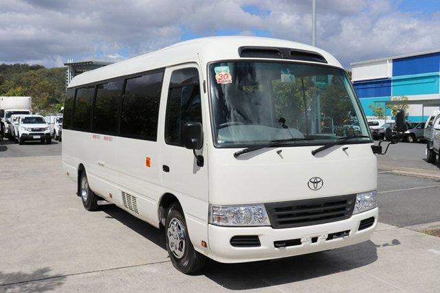 Used Toyota Coaster 50 Deluxe Robina, 2016 Toyota Coaster 50 Deluxe White Automatic Midi Coach