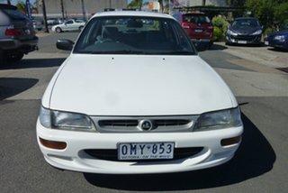 1995 Holden Nova LG SLX White 5 Speed Manual Sedan.