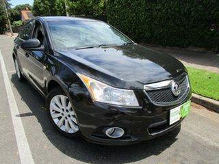 2011 Holden Cruze JH CDX Black 5 Speed Manual Sedan.
