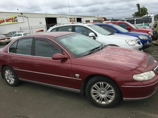 1999 Holden Calais VTII Maroon 4 Speed Automatic Sedan.