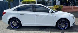 2011 Holden Cruze JG CDX White 6 Speed Sports Automatic Sedan.