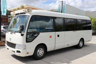 2015 Toyota Coaster XZB50R Deluxe White Manual Midi Coach.