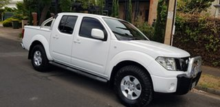 2010 Nissan Navara D40 ST (4x4) White 5 Speed Automatic Dual Cab Pick-up.