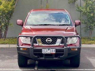 2009 Nissan Navara D40 ST-X King Cab Maroon 5 Speed Automatic Utility.