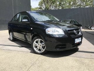 2010 Holden Barina TK MY10 Black 4 Speed Automatic Sedan.
