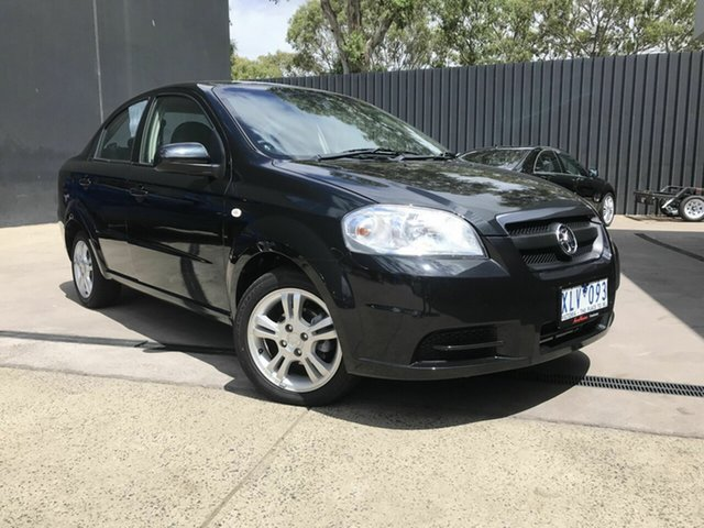 Used Holden Barina TK MY10 Fawkner, 2010 Holden Barina TK MY10 Black 4 Speed Automatic Sedan
