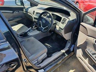 2013 Honda Civic 9th Gen Ser II MY13 VTi-L Black 5 Speed Sports Automatic Sedan.