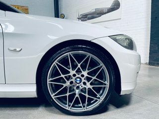 2009 BMW 3 Series E90 MY10 323i Steptronic White 6 Speed Sports Automatic Sedan.